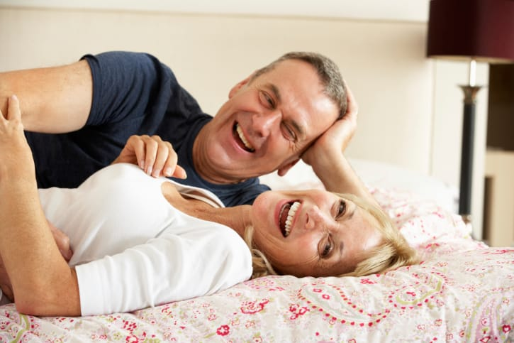 Couple in Menopause in Bed - Stages of Sex Series: Menopause and the Slowing Down Years